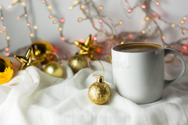 Christmas coffee cup with new year decorations on background royalty free stock photography