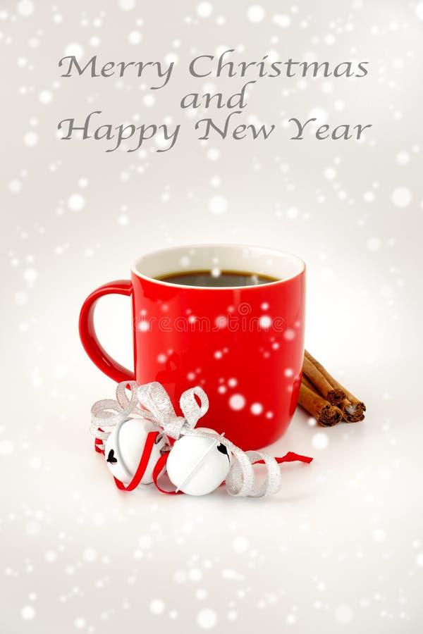 Christmas Coffee Mug with Jingle Bells, Cinnamon Sticks and Snowfall stock photo