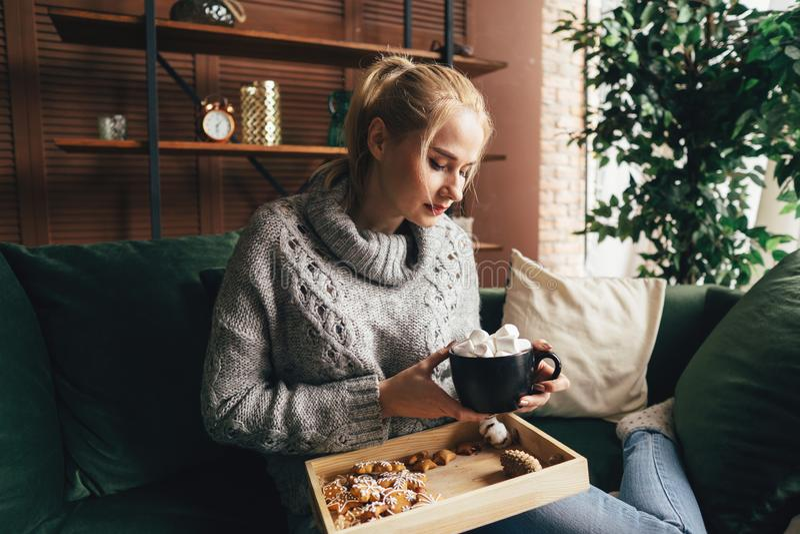 Warming, hygge mood. Woman drinking hot chocolate royalty free stock image