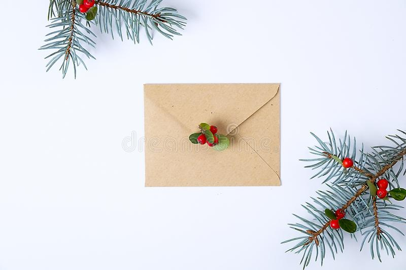Christmas collection with envelope, ribbon, red berries for mock up template design. View from above. Flat lay, copy space. stock photography