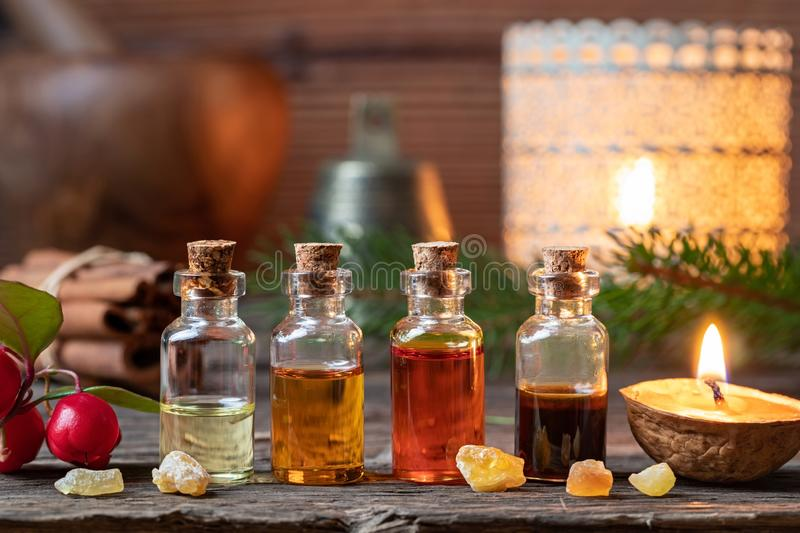 Christmas collection of essential oils with frankincense, winter stock images