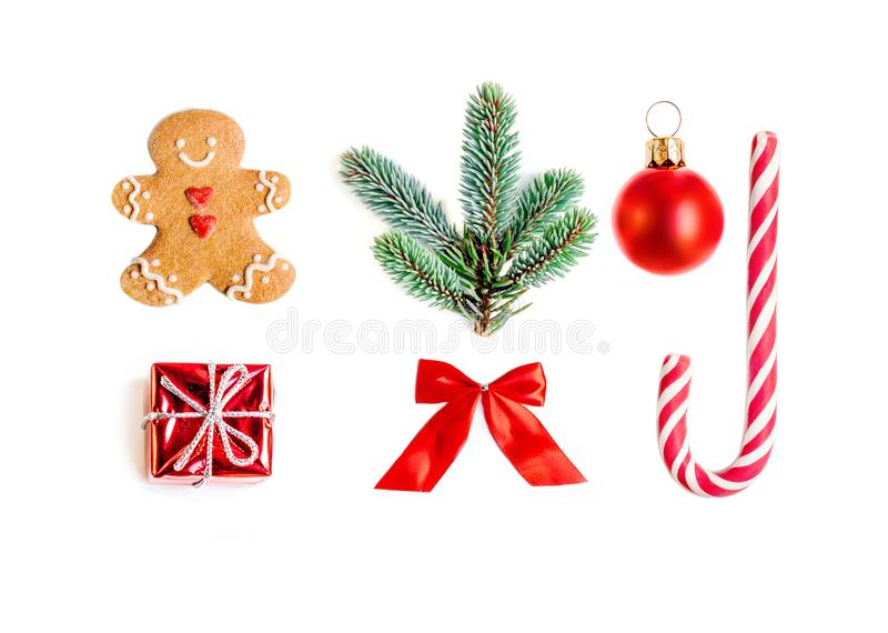Christmas collection with gifts, fir tree, gingerbread man cookie and ornaments isolated on white background close up. Flat royalty free stock images