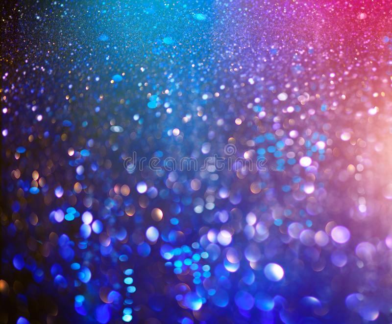 Christmas colorful background. Holiday glowing backdrop. Defocused Background With Blinking Stars. New Year Blurred Bokeh. Curtain, Abstract Colorful bright royalty free stock photography