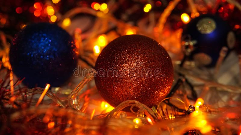 Christmas colorful New Year`s Bokeh neon lights. Abstract Blurred photo background with blinking lights from garlands and balls. D. Ecoration with bright colored stock image