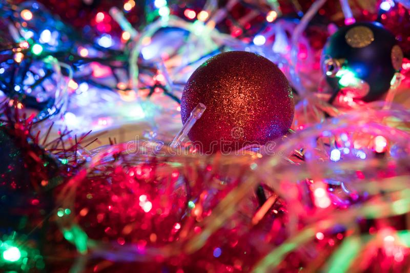 Christmas colorful New Year`s Bokeh neon lights. Abstract Blurred photo background with blinking lights from garlands and balls. D royalty free stock images