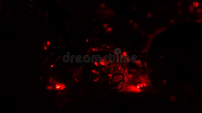 Christmas colorful New Year`s Bokeh neon lights. Abstract Blurred photo background with blinking lights from tangled garlands. Dec. Oration with bright colored stock illustration