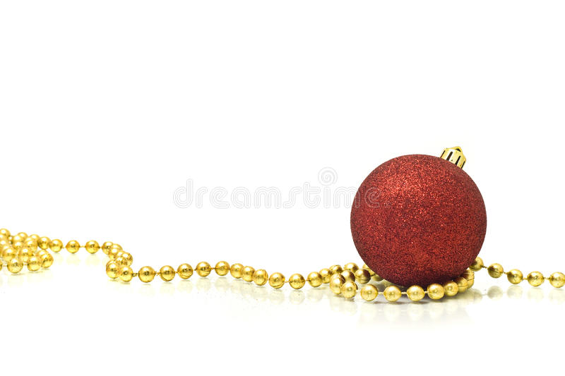 Christmas. Colorful red ball and golden beads royalty free stock photography