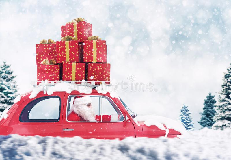 Santa Claus on a red car full of Christmas present with winter background drives to deliver royalty free stock photos