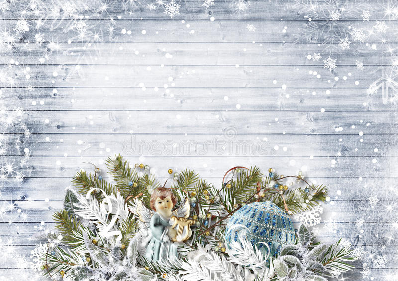 Christmas composition with angels,gift,snowy fir tree stock image