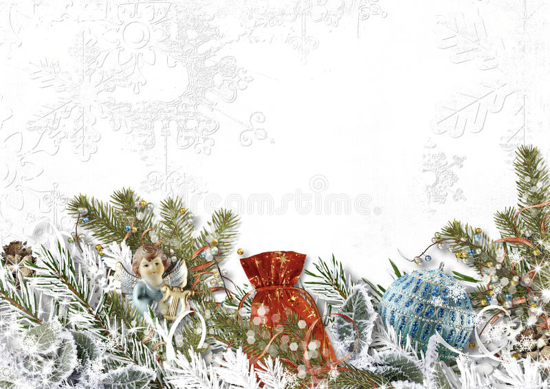 Christmas composition with angels,gift,snowy fir tree. Christmas background with beautiful decor of fir branches, angels,gift,snowy fir tree, holly with place royalty free stock photos