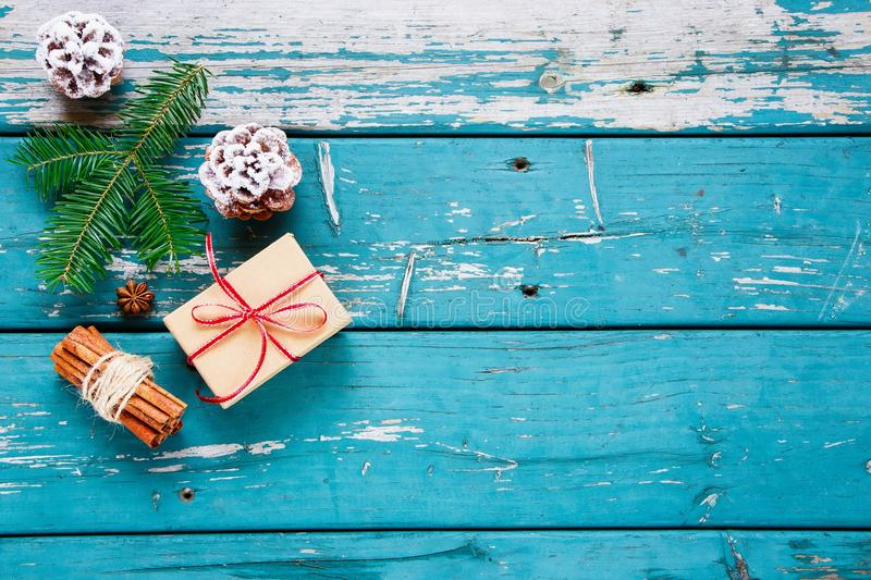 Christmas composition background. Christmas and New Year decoration. Composition with Christmas gift, pine cones, fir branch, cinnamon sticks and anise star over royalty free stock image