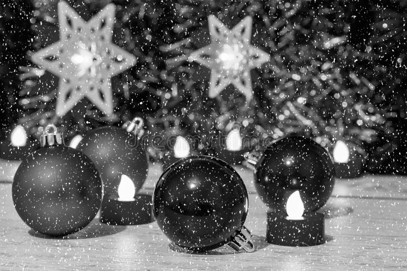 Christmas composition with balls and candles, black-white royalty free stock images