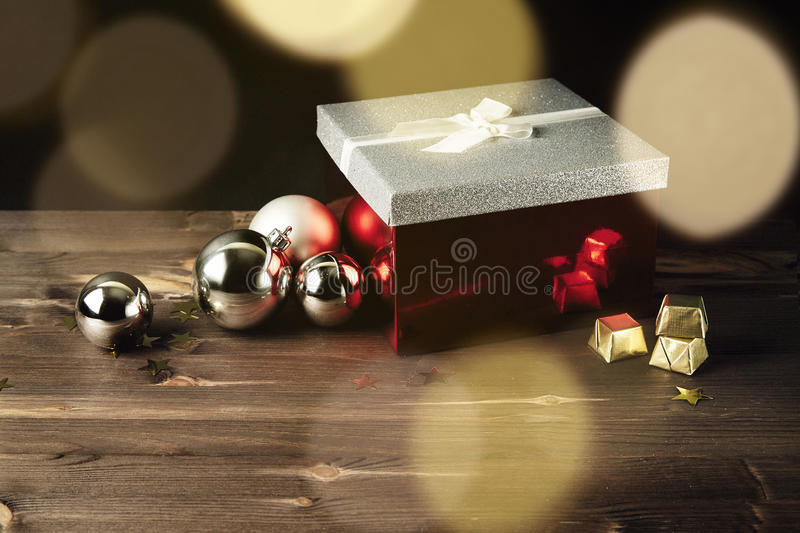 Christmas composition with box gifts, toys, tree. Flare and light on background. Rustic wooden table. New year concept. Holiday d. Ecor. Top view, copy space stock photography