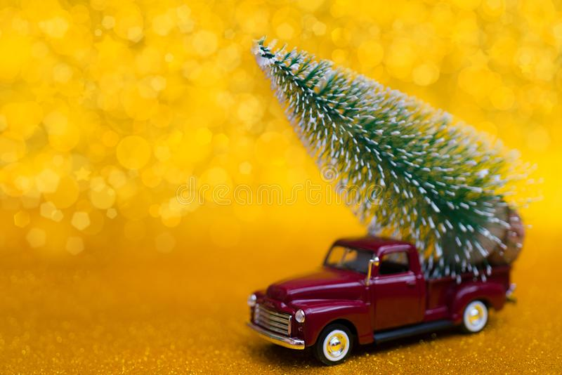 Christmas composition with a car and a tree. stock images