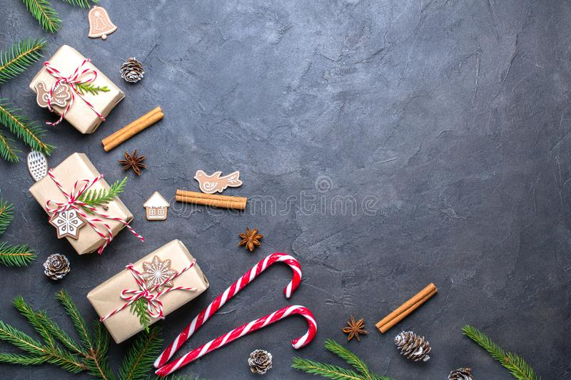 Christmas composition. Christmas gift, decorations , pine cones, fir branches on black background.copy space royalty free stock images