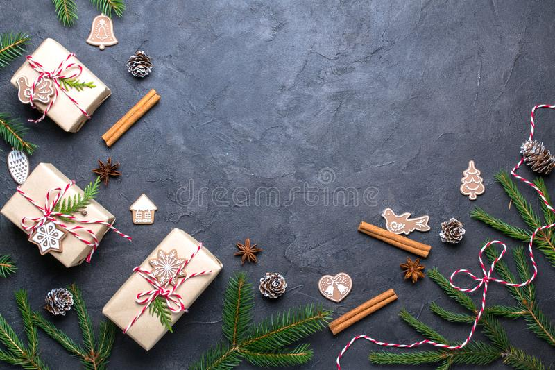 Christmas composition. Christmas gift, decorations , pine cones, fir branches on black background.copy space stock photos