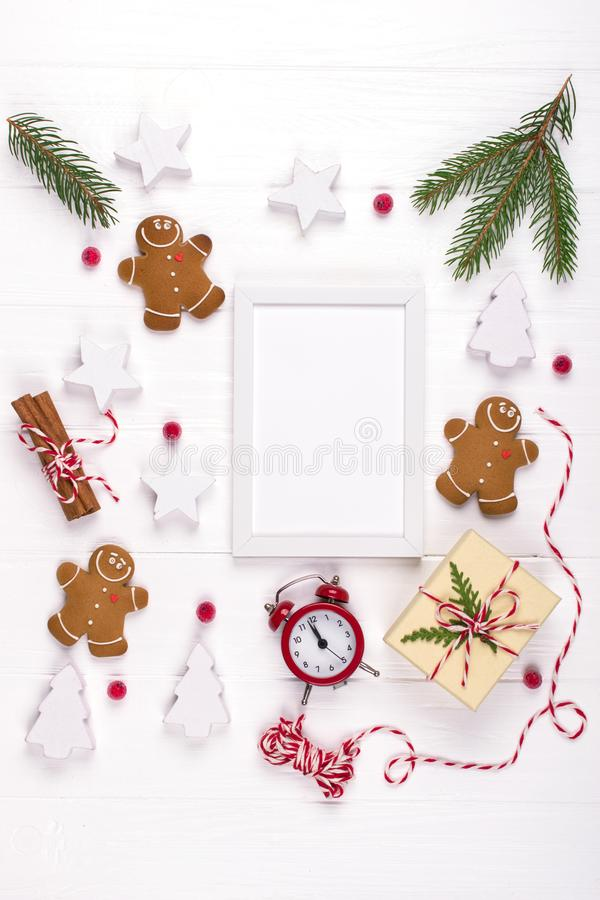 Christmas composition. Christmas gifts, decor, fir tree branches gingerbread man cookies . Winter holidays concept. stock photography