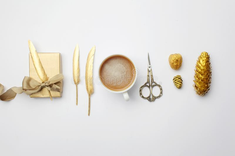 Christmas composition. christmas golden decorations on light background. Top view, flat lay stock photo