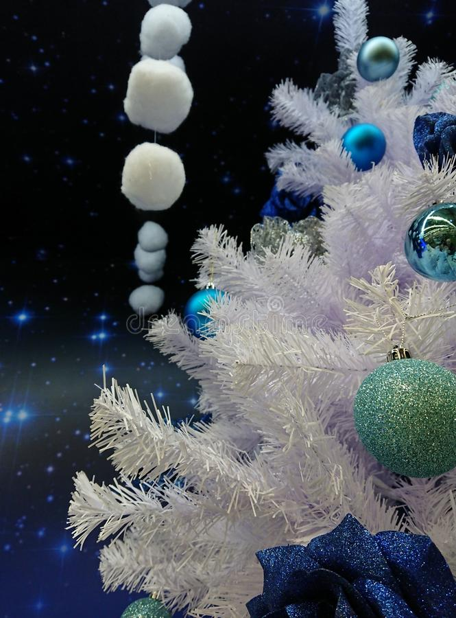 Christmas tree in different toys. Christmas composition of a Christmas tree and toys in blue and white colors stock photo