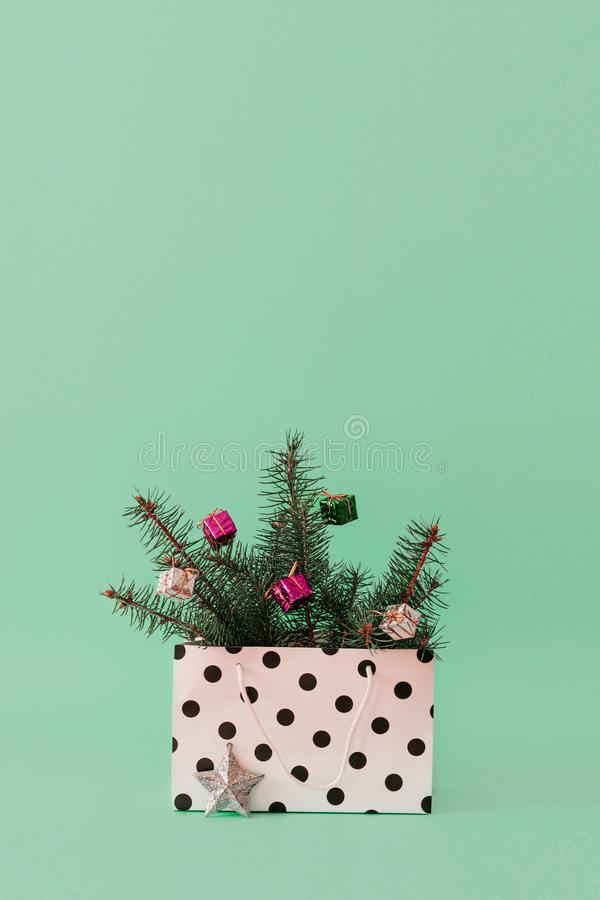Christmas composition with Conifer Evergreen tree branches and bauble ball in gift bag. Christmas and 2020 new year minimal royalty free stock photos