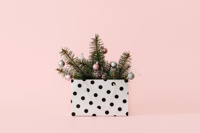 Christmas composition with Conifer Evergreen tree branches and bauble ball in gift bag. Christmas and 2020 new year minimal royalty free stock images