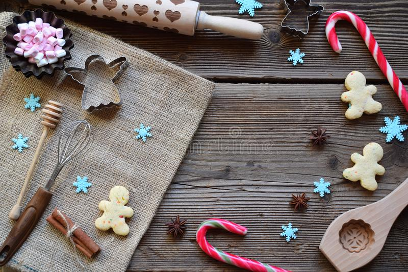 Christmas composition with cookies, festive decoration, gingerbread spices, marshmallows, candy. Preparation for holiday baking. N royalty free stock images