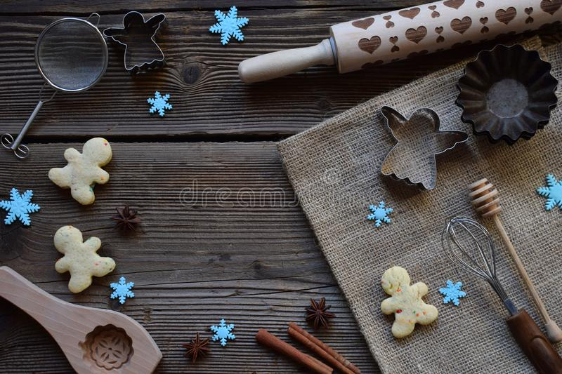 Christmas composition with cookies, gingerbread spices, rolling pin, muffin molds. Preparation for holiday baking. New Year, Xmas. Concept. Top view, with copy royalty free stock photography