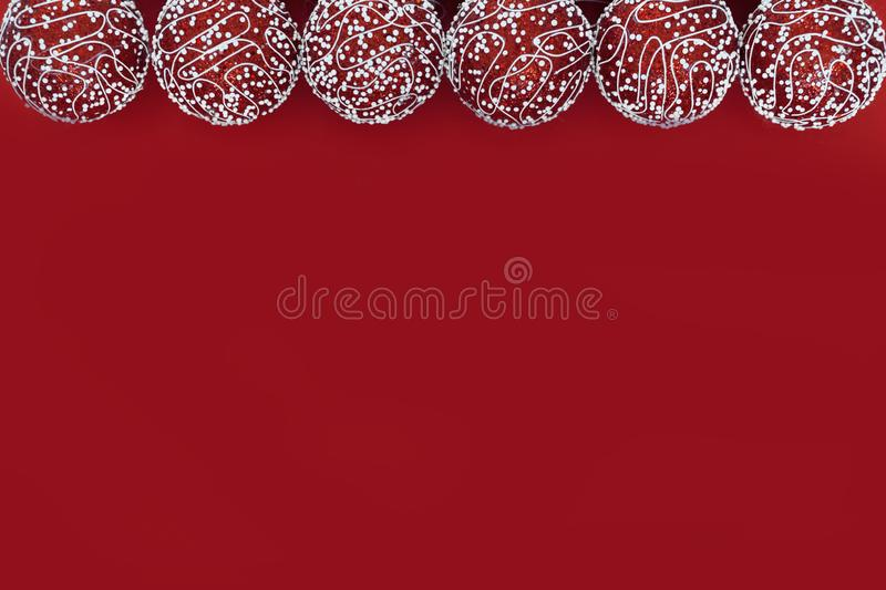 Christmas composition with copy space. New year balls or bubles red decorations on paper red background. Christmas, winter,. Red balls Christmas holiday shiny stock photo