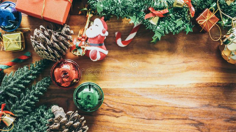 Christmas composition copy space for your text. Gift box, ball, bell shiny and Christmas tree Miniature on wood flat lay, top view royalty free stock images