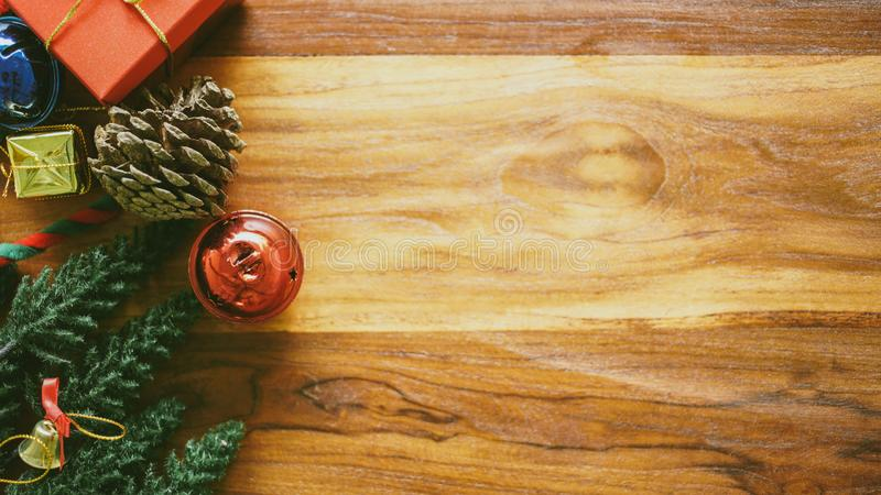 Christmas composition copy space for your text. Gift box, ball, bell shiny and Christmas tree Miniature on wood flat lay, top view stock photography