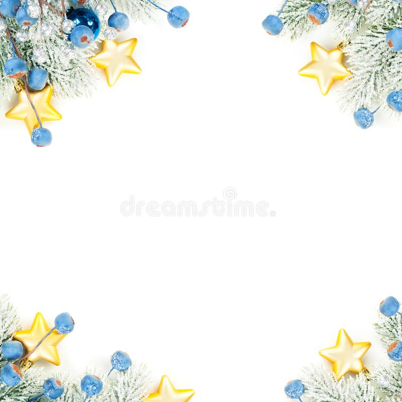 Christmas composition corner top view. Colorful winter background with green Xmas tree twig, blue decoration and gold stars. Isolated on white background stock photography