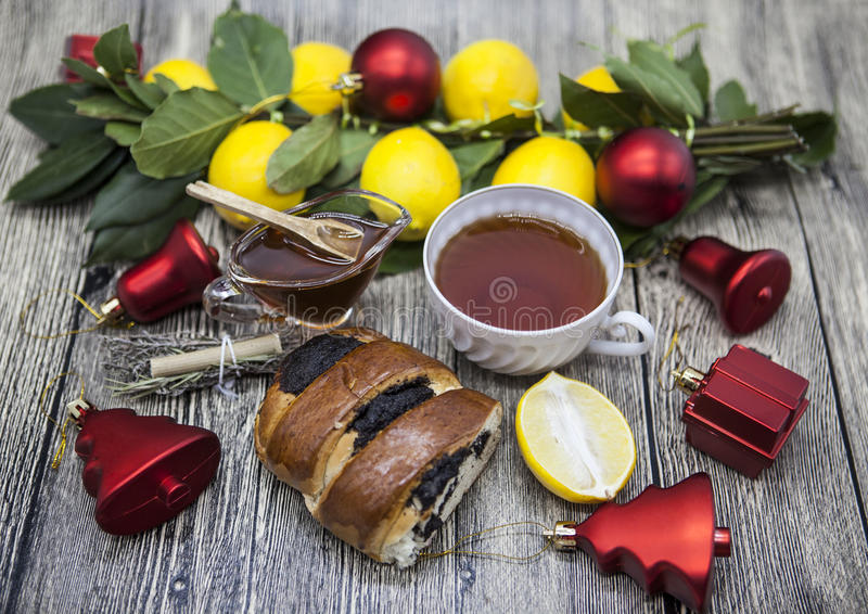 Christmas composition with Cup of tea lemon cookies Christmas toys and honey in a glass vase royalty free stock images