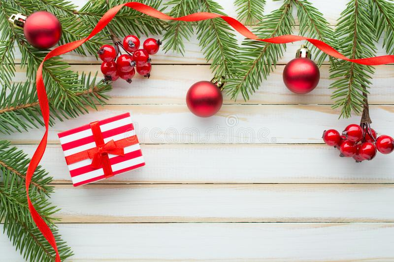 Christmas composition. Decorated with fir branches and gift box stock image