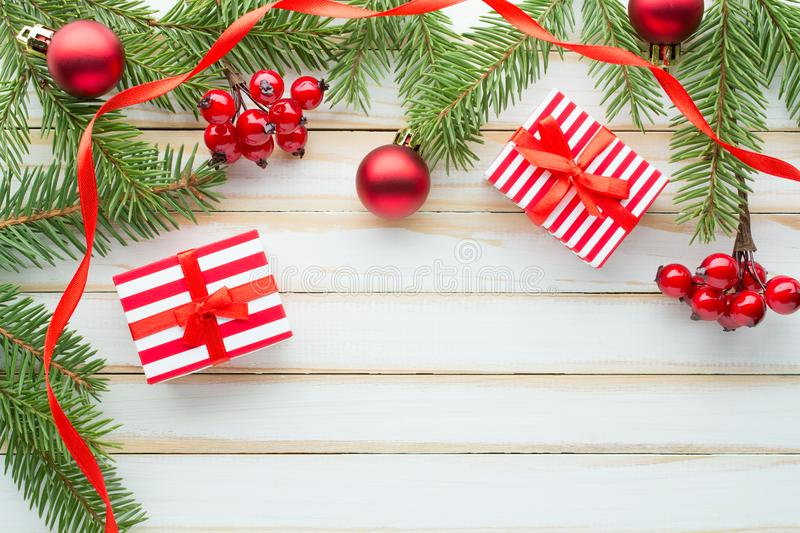 Christmas composition. Decorated with fir branches and gift boxes royalty free stock images