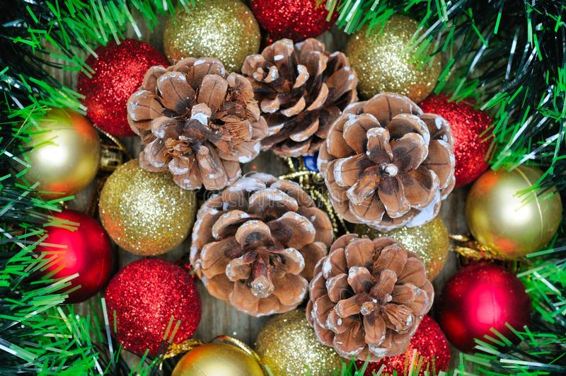 Christmas composition with Christmas decorations. Tinsel and pine cones stock photos