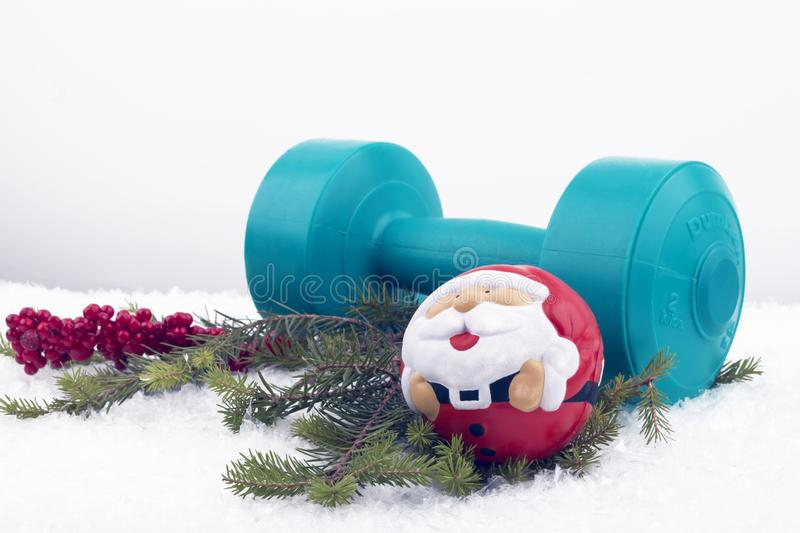 Christmas composition with dumbbell and hand expander. stock photography