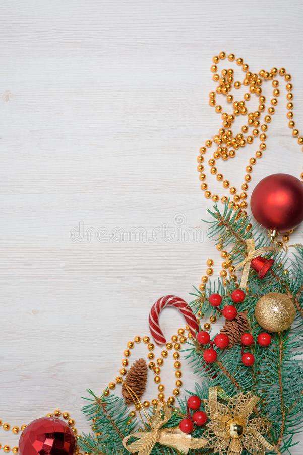 Christmas composition with fir tree branches and festive decoration on gray background royalty free stock photo