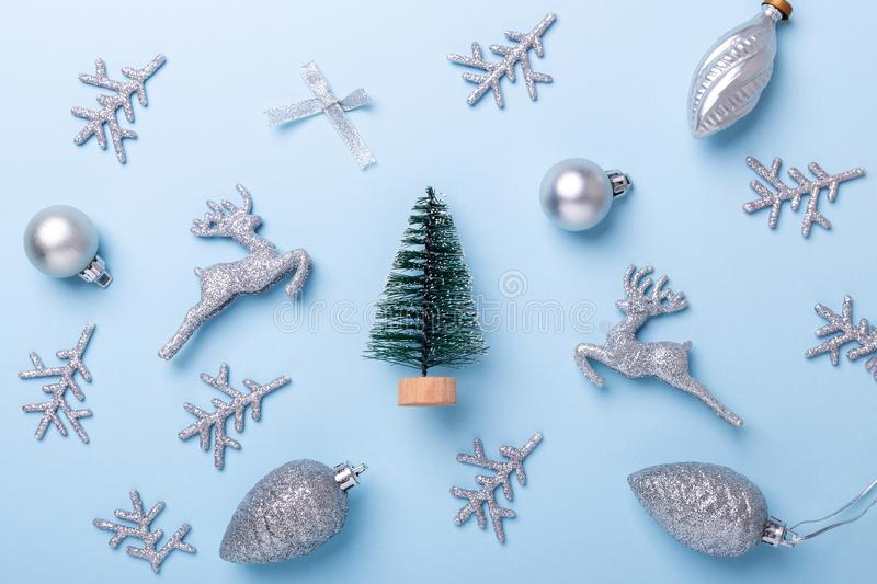 Christmas composition Fir tree and silver decoration on pastel blue background. Christmas, winter, new year concept royalty free stock image