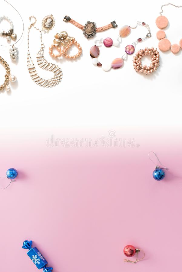 Christmas composition flat lay the balls jewelry necklace bracelet vintage pearls on a pink gradient background white to blue Top stock images
