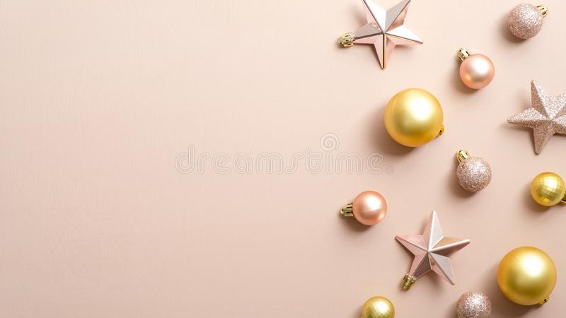 Christmas composition. Frame border made of balls and stars on pastel ivory background. Christmas, winter, new year concept. Flat. Lay, top view, copy space royalty free stock photography
