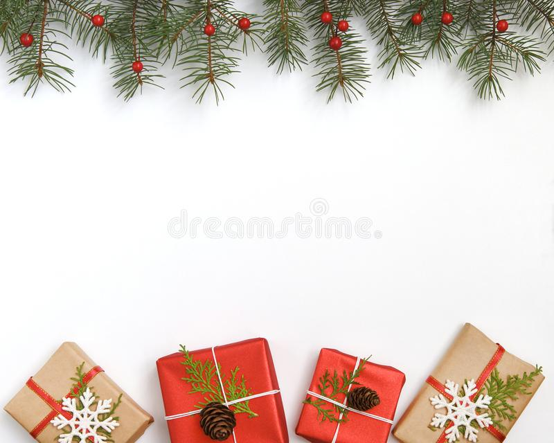 Christmas composition. Frame made of christmas gifts, pine branches on white background. Flat lay, top view, copy space stock photos