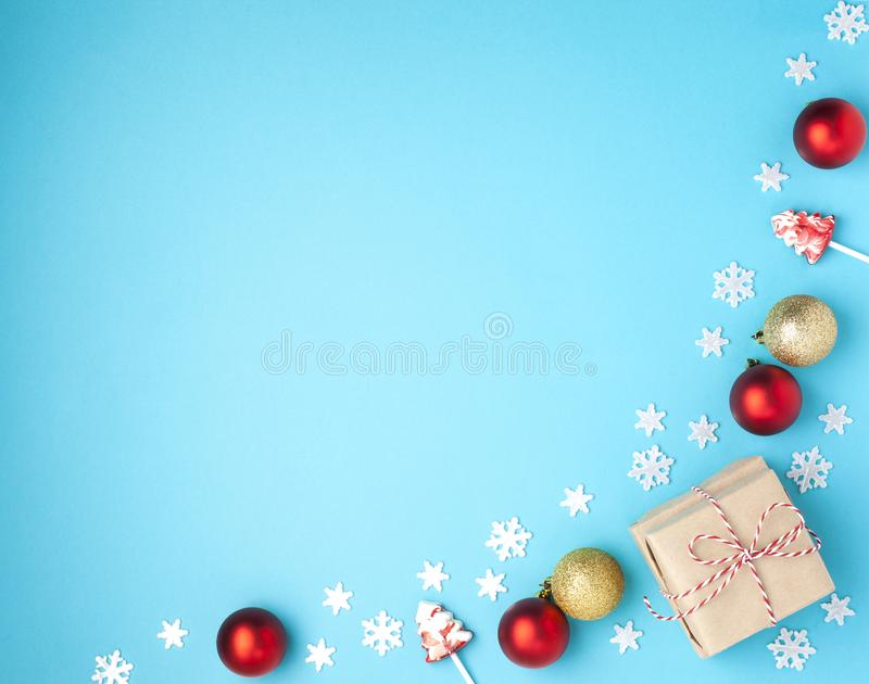 Christmas composition. Frame from red balls, gift, lollipops and snowflakes on pastel blue background. Christmas, winter, new year royalty free stock photos