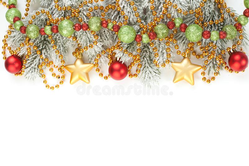 Christmas composition. Christmas garland, fir branches, holly berries isolated on white background. Xmas or New Year top view royalty free stock photos