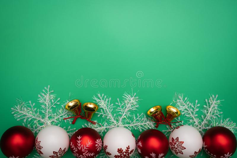 Christmas composition. Christmas gift, bell and ball on green background. Flat lay, top view, copy space royalty free stock images