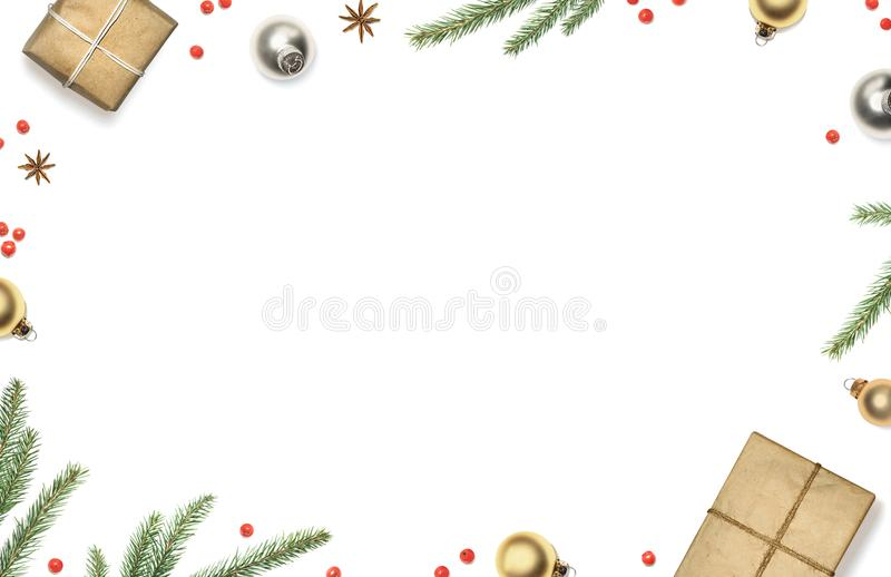 Christmas composition with gift boxes, decorations, christmas tree branches and red berries framed white background, top view stock images