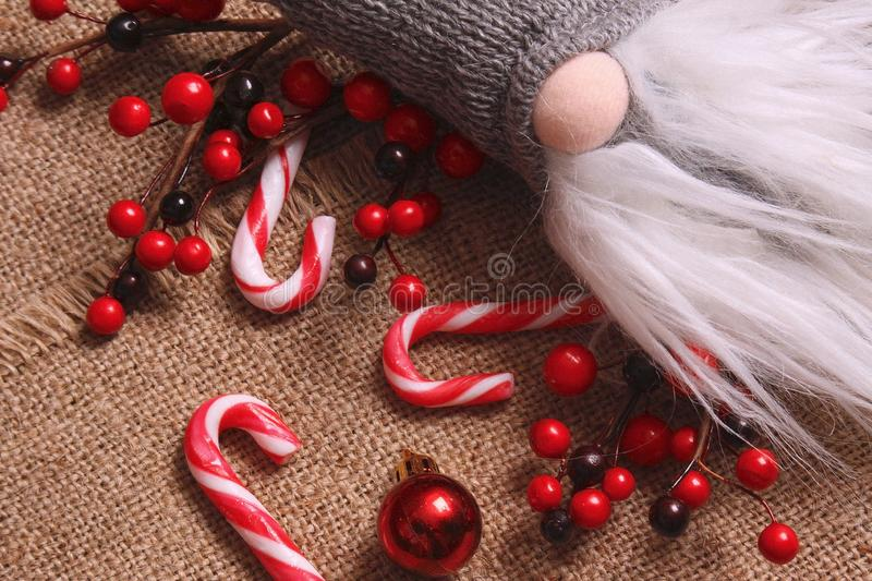 Christmas composition. Gifts, red decorations on linen background. Christmas, winter, new year concept. Flat la royalty free stock photo