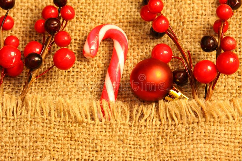 Christmas composition. Gifts, red decorations on linen background. Christmas, winter, new year concept. Flat la royalty free stock photos