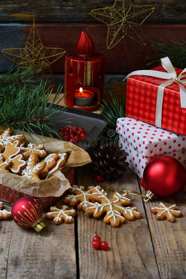 Christmas composition with gingerbread cookies, gifts, festive decoration and fir tree branch. Holiday, New Year, Xmas concept. Vi royalty free stock photos