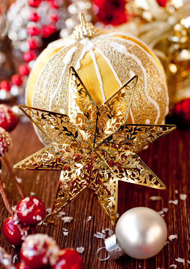 Christmas composition with a gold star and decorat