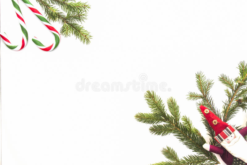 Christmas composition. Green fir tree branch, Xmas gifts and candy canes on white background. Top view, flat lay. Copy royalty free stock photography